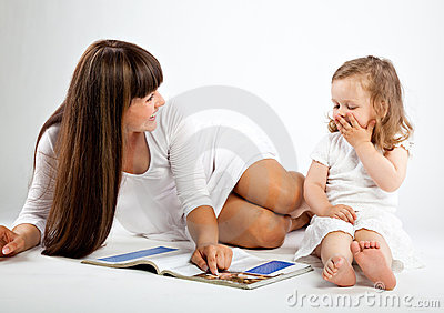 Mother  and little daughter reading book