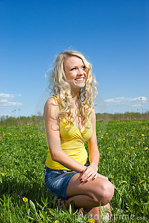 Young  Sexy  woman on year meadow