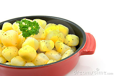 Red pan with fresh baked potatoes