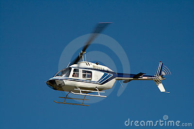 White helicopter in flight