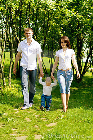 Mother, father and baby walking