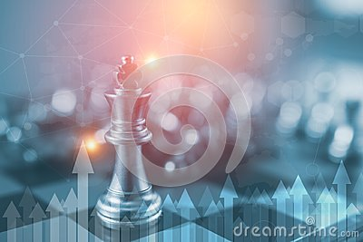 Investment Leadership Concept : The king chess piece with chess others nearby go down from floating board game concept of business