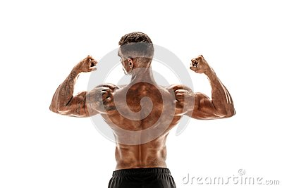 Bodybuilder showing his back and biceps muscles isolated on a white background, personal fitness trainer.