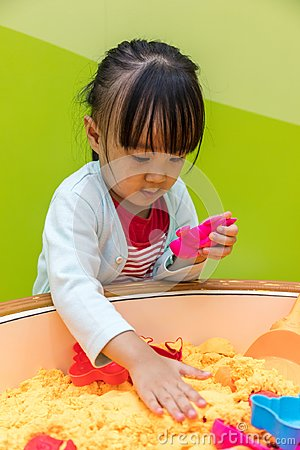 Asian Chinese Little Girl Playing Kinetic Sand