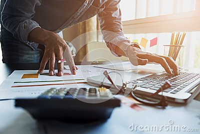Accountants work analyzing financial reports on a laptop at his