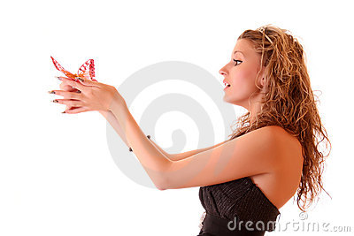 Girl holds butterfly
