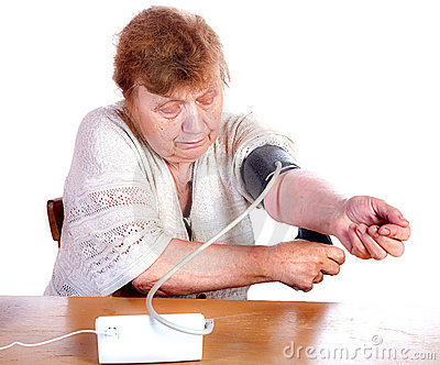 The old woman measures arterial pressure upon