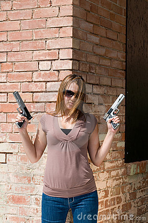 Girl with handguns