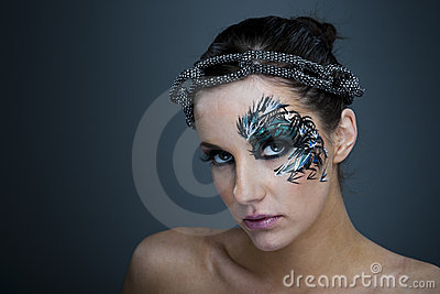 Girl with beautiful artistic face painting