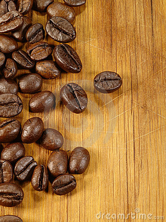 Coffee beans on the wooden desk