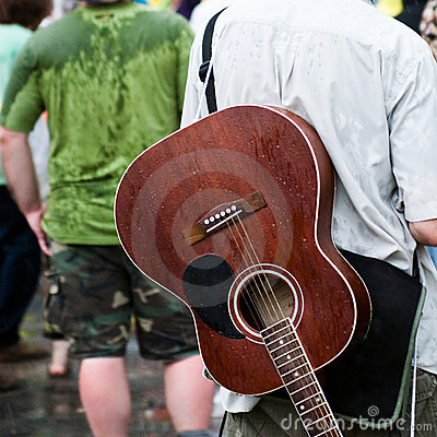 Rainy day wirh a brown guitar on a concert