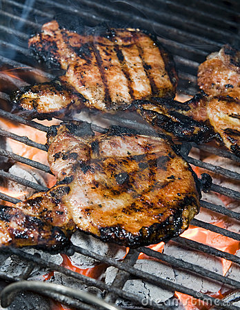 Pork chops on the barbecue grill