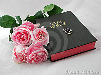 Wedding rings on holy bible