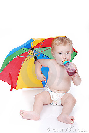 Baby in white with umbrella