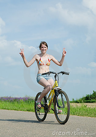 Girl goes on bicycle