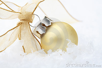 Gold Christmas bauble decoration with ribbon.