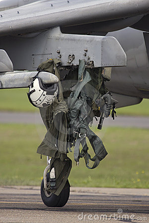 Flight suit on aircraft wheel
