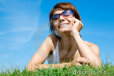 Young woman lying on the green grass