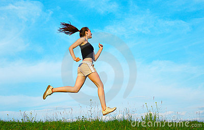 Woman run on green grass
