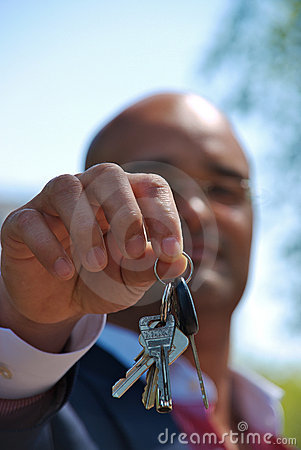 Close up of businessman handing over his keys
