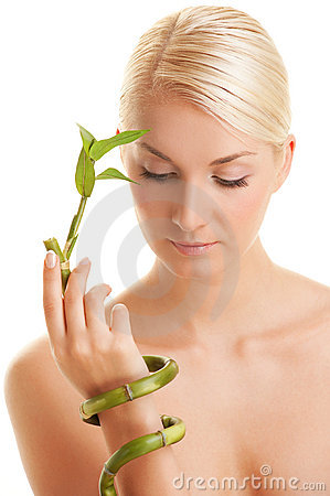 Woman with a bamboo plant