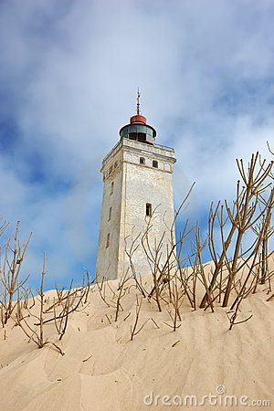 Lighthouse in desert by the sea