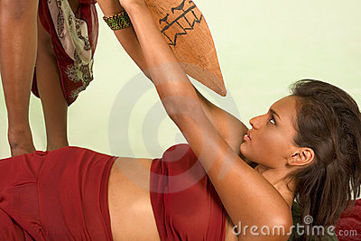 Dark skinned woman is attacked with use of spear