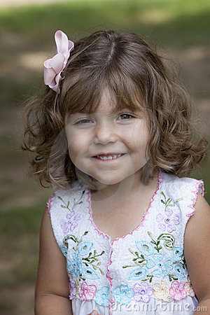 Smiling child with curly hair