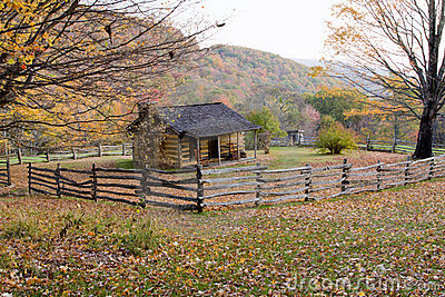 Autumn Log Cabin with Rail Fence