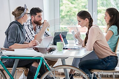 Four proficient freelancers and independent contractors co-worki
