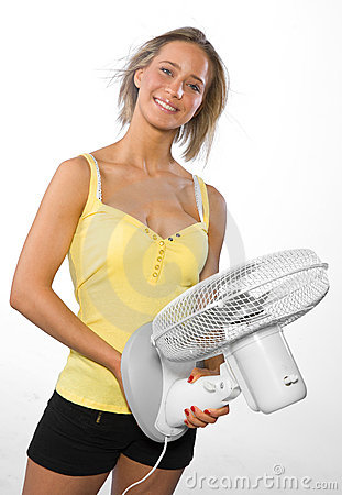 Girl cooling herself with fan