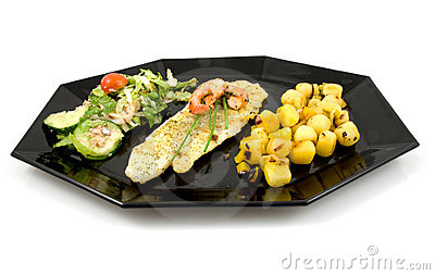 Plate with fish, potatoes and lettuce