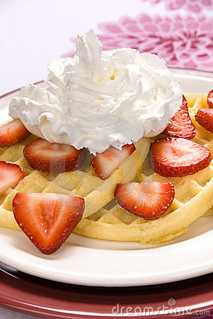 Strawberry waffles with whipped cream