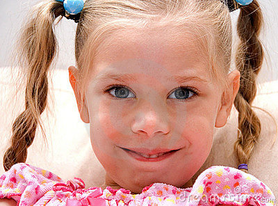Cute Little Girl in Braided Pig Tails