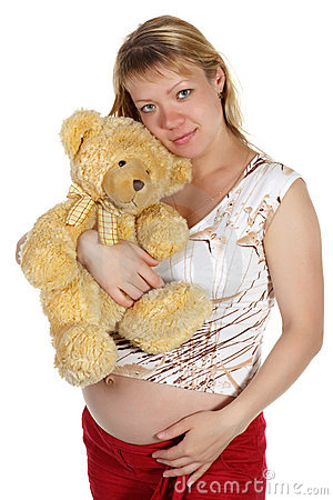 The pregnant woman with a teddy bear