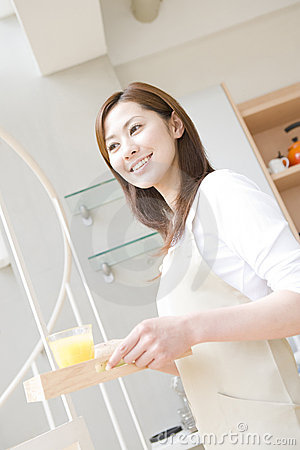 Japanese woman Carrying a orange juice