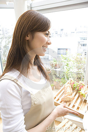 Japanese woman carrying a meal