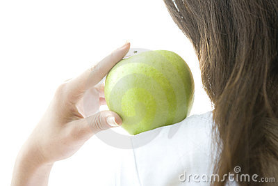 Green apple on the woman's shoulder