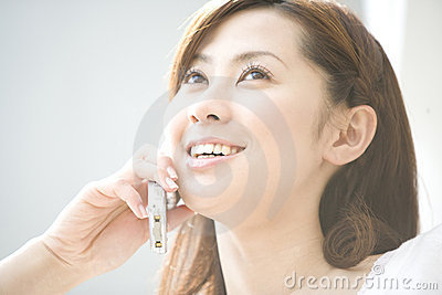Japanese woman talking with cell phone