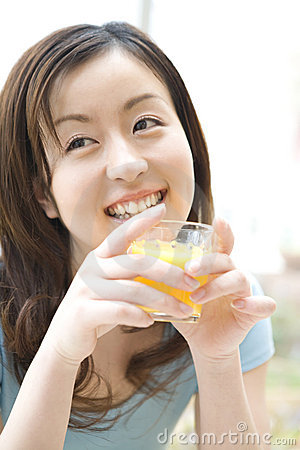 Japanese woman drinking a orange juice