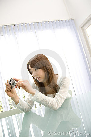 Japanese woman taking a photo