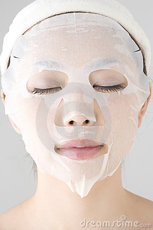 Face of woman with a facial pack