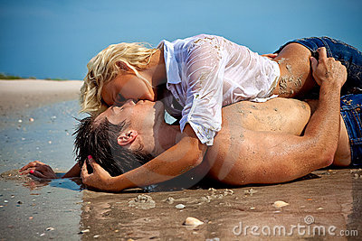 Couple in love at the beach kissing