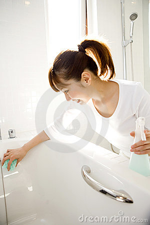 Japanese woman cleaning up the bathtub