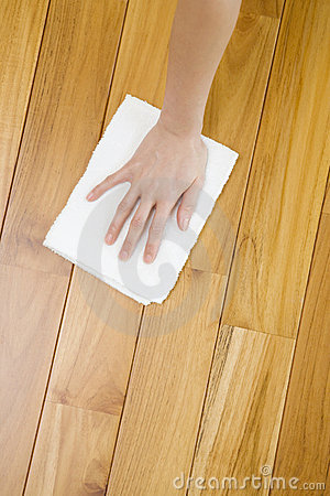 Hand sweeping a floor