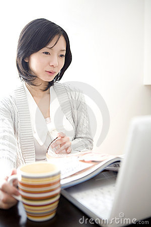 Japanese woman operating a PC
