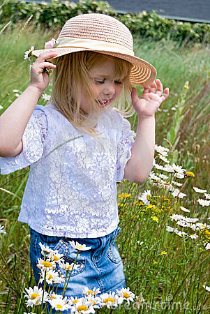little girl in wild daisy field