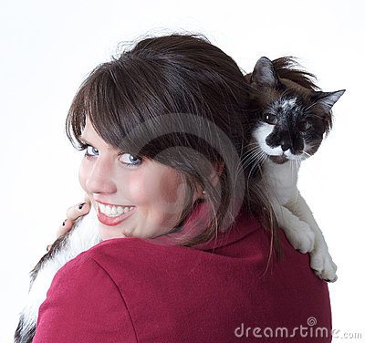Young woman holding cat, isolated