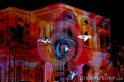 Acrobatic Performance Against Museum Backdrop