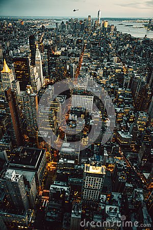 Manhattan New York City buildings lights aerial top view at the night time